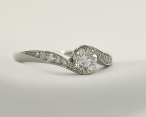 Diamond & Platinum Crossover Engagement Ring with Diamond Set Shoulders
