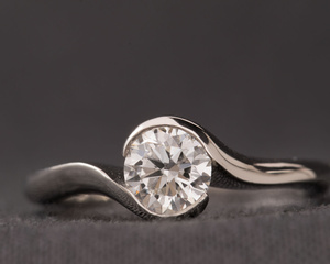 Diamond & Platinum Crossover Engagement Ring