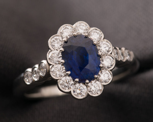 Sapphire & Platinum Cluster Engagement Ring with a Scalloped Edge