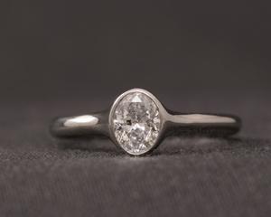 Oval Diamond & Platinum Engagement Ring